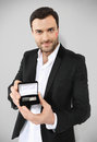 Attractive man holding black box cufflinks Royalty Free Stock Photos