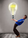 Attractive man holding realistic d light bulb young Royalty Free Stock Photo