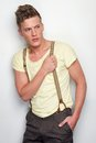 Attractive Man Holding Suspenders Stock Image