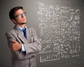 Attractive man looking at stock market graphs and symbols young Royalty Free Stock Image