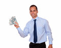 Attractive man looking at you holding cash money portrait of an on isolated background Royalty Free Stock Photos