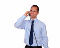 Attractive man looking at you speaking on phone portrait of an while is standing over white background Royalty Free Stock Photos