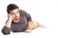 Attractive man lying floor Royalty Free Stock Image