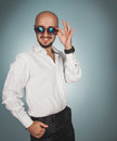 Attractive man in sunglasses smiling Royalty Free Stock Photo