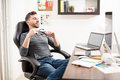 Attractive man taking a break from work Royalty Free Stock Photo