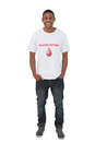 Attractive man wearing blood donor tshirt on white background Stock Photo