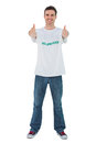 Attractive man wearing volunteer tshirt giving thumbs up on white background Stock Photography