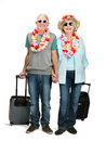 An attractive mature couple on vacation on white Royalty Free Stock Photos
