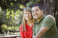 Attractive Mixed Race Couple Portrait at the Park Stock Photography