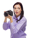 Attractive mixed race young woman with dslr camera on white isolated a background Stock Photo