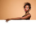 Attractive model behind blank white banner black woman standing large Royalty Free Stock Image