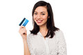 Attractive model displaying credit card smiling asian young female holding up Stock Images