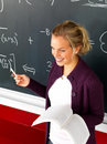 Attractive modern teacher teaching math Stock Photography