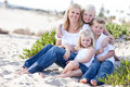 Attractive Mom and Her Cute Children at The Beach Royalty Free Stock Images
