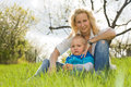 Attractive mom and her son outdoors. Royalty Free Stock Photography