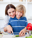 Attractive mother and her son cooking Royalty Free Stock Photos