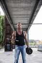 Attractive muscular hunk man lifting weights outdoor handsome showing healthy body while looking at the camera Royalty Free Stock Image