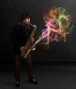 Attractive musician playing on saxophone with colorful abstract young fume comming out Royalty Free Stock Photos
