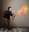 Attractive musician playing on saxophone with colorful abstract young fume comming out Royalty Free Stock Photography