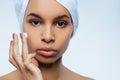 Attractive nice woman using moisturizing cream