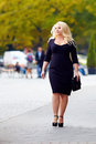 Attractive overweight woman walking the city street alone Stock Image