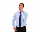 Attractive pensive adult man looking up portrait of an against white background copyspace Royalty Free Stock Image