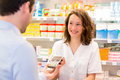 Attractive pharmacist taking healt insurance card view of an Stock Images