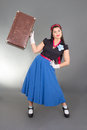 Attractive pinup girl retro suitcase over grey Stock Photos
