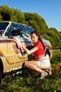 Attractive pinup girl washing a car at summer Royalty Free Stock Image
