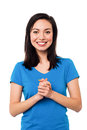 Attractive pretty chinese female model young girl posing with clasped hands isolated on white Stock Photography