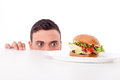 Attractive pretty young man is very hungry Royalty Free Stock Photo
