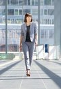Attractive professional business woman walking Royalty Free Stock Photo