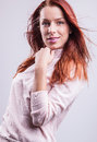 image photo : Attractive red hair woman. Studio portrait.