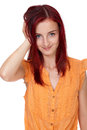 Attractive redhead girl in orange shirt, isolated Stock Photography