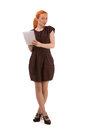 Attractive redhead woman writing notes Royalty Free Stock Photo