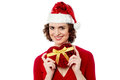 Attractive santa woman with gift box beautiful gorgeous xmas Royalty Free Stock Photos