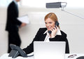 Attractive secretary attending phone call Stock Images