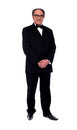 Attractive senior man posing in tuxedo Stock Photo