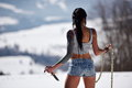 Attractive sensual woman in shorts holding knife outdoor winter Stock Image