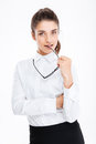 Attractive sensual young businesswoman standing and holding glasses Royalty Free Stock Photo