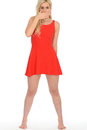 Attractive Sexy Shocked Young Blonde Woman Wearing a Short Red Mini Dress Royalty Free Stock Photo