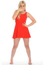 Attractive Shocked Young Blonde Woman Wearing a Short Red Mini Dress Royalty Free Stock Photo