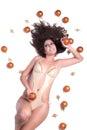Attractive sexy woman with shine gold bikini lying, Christmas balls around her Royalty Free Stock Photo