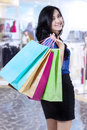 Attractive shopping woman in shopping centre Stock Photo