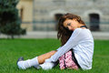 Attractive short skirt young girl sitting on the grass in bogazici universitesi turkey Stock Photography