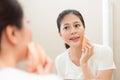 Attractive slim woman using cosmetic sponge makeup