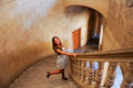 Attractive smiling blonde woman on stairs Royalty Free Stock Photo