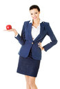 Attractive smiling businesswoman holding red apple Royalty Free Stock Photo