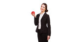 Attractive smiling businesswoman holding red apple, isolated on white Royalty Free Stock Photo