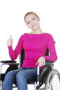 Attractive smiling disabled woman sitting in a wheel chair isolated on white Royalty Free Stock Images